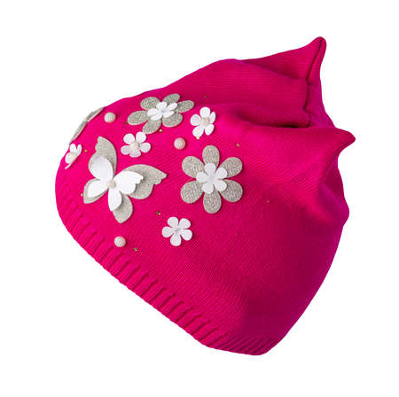 women's red knitted hat with sewed flowers isolated on white background. warm winter accessory