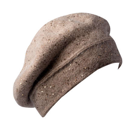 female light brown beret isolated on white background. autumn accessory