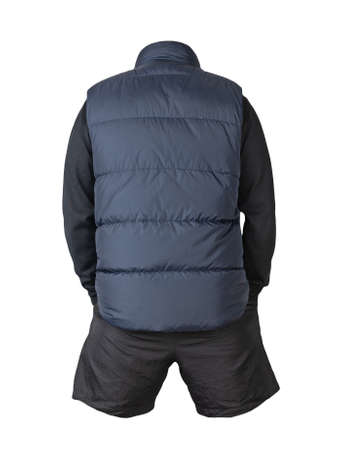 Dark blue sleeveless jacket, black sweater and black sports shorts isolated on white background. clothes for every day 免版税图像