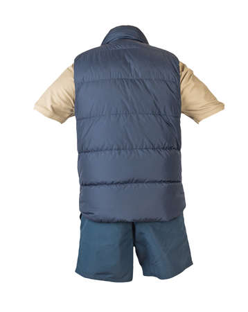 Dark blue sleeveless jacket, beige t-shirt with collar on buttons and dark blue sports shorts, isolated on white background. Current clothes for cool weather