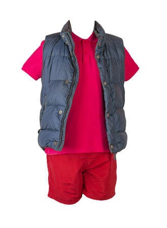 Dark blue sleeveless jacket, red t-shirt with collar on buttons and red sports shorts, isolated on white background. Current clothes for cool weather