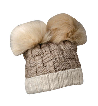 knitted white beige hat isolated on white background.hat with pompon. 免版税图像