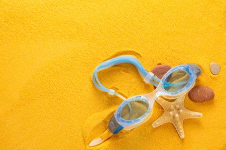 Blue swimming goggles  and starfish  photo