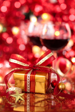Gift and wine for holidays against blured lights. photo
