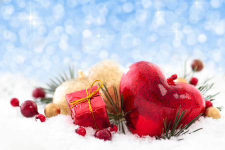 Christmas decoration with hearts, gift and berries. photo