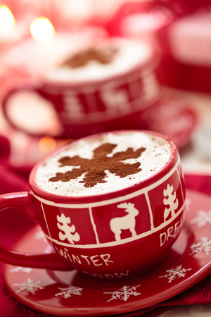 Christmas decorated cups with hot chocolate for holidays.