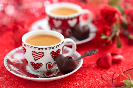 Cups of coffee and roses for Valentine's day. photo