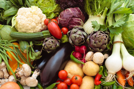 fresh produce: Background of mixed fresh organic vegetables and herbs.