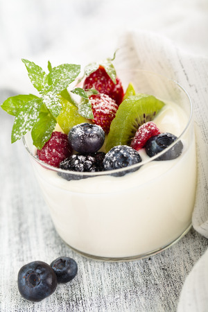 lifestile: Fresh yogurt with berries and mint leaves.