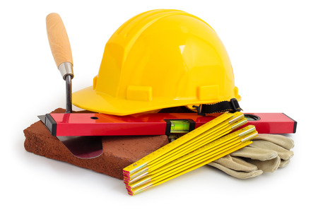 hard: Yellow safety hard hat and construction tools. Isolated on white background.
