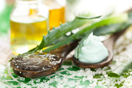 Aromatherapy spa background with  aloe, sea salt, essential oil and plant extracts.