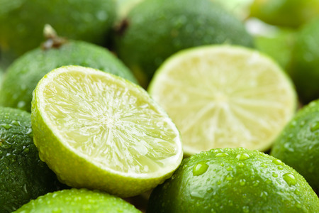 Backgrounds. Close up shot ofwet  limes. Focus on the central part of sliced lime.