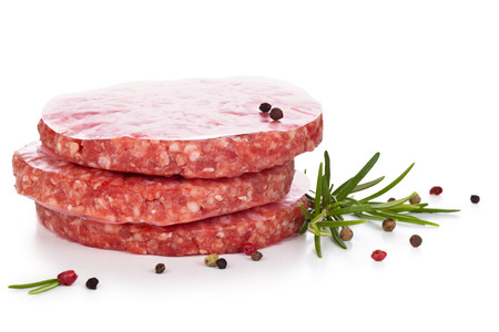 hamburger: Uncooked hamburgers with rosemary and pepper. Isolated on white background.