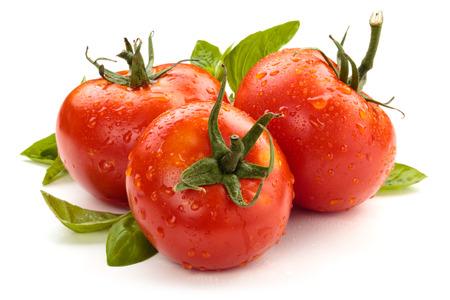 Ripe wet tomatoes isolated on white background.