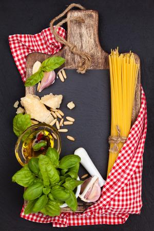 herba: Italian Food. Italian pasta and pesto ingredients on black slate board.