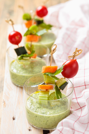 cold soup: Vegetable sticks and green cold soup gazpacho . Stock Photo