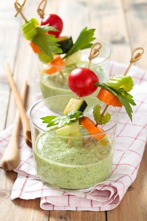 gazpacho: Vegetable sticks and green cold soup gazpacho . Stock Photo