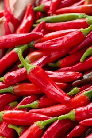 Background of ripe red chili peppers . Standard-Bild