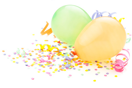 new year eve confetti: Birthday arrangement. Balloons and confetti isolated on white. Stock Photo