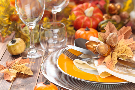 background settings: Autumn place setting with leaves, candles and pumpkins. Stock Photo