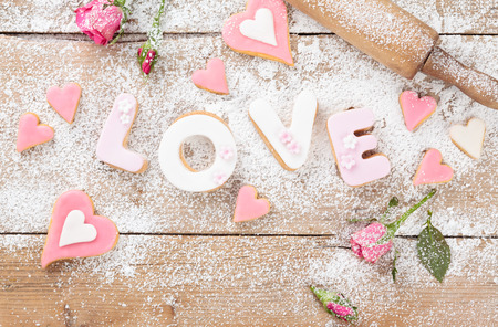 holiday cookies: Letter cookies for Valentines day or wedding day. On old wooden table. Stock Photo