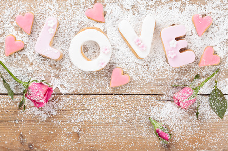 day break: Letter cookies for Valentines day or wedding day. On old wooden table. Stock Photo