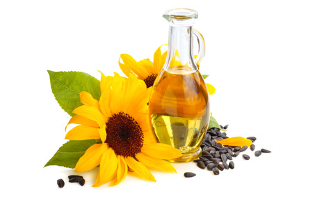 Sunflowers, sunflower oil and sunflower seeds. Isolated on white background.