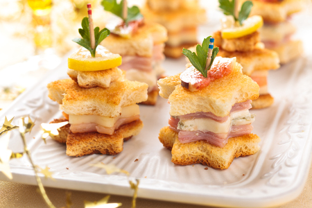 buffet dinner: Star shaped toasts with smoked salmon, ham and cheese.