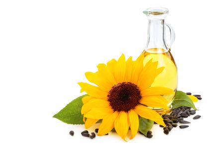 semilla: Girasoles, aceite de girasol y semillas de girasol. Aislado en el fondo blanco.