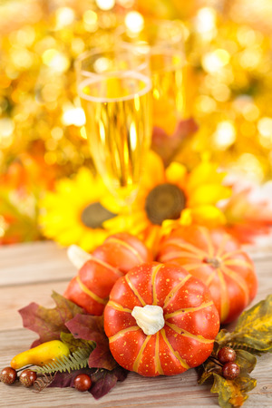 autumn arrangement: Autumn arrangement with wine, sunflowers and pumpkins. Stock Photo