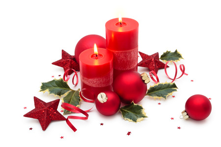 Christmas decoration with candle isolated on white background.