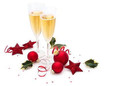 クリスマス ボール、星、ひいらぎの葉、白い背景で隔離のシャンパン。 写真素材
