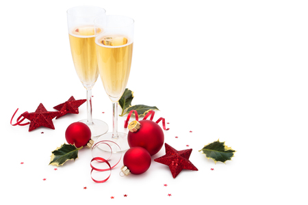celebration champagne: Christmas balls, stars, Holly leaves  and champagne  isolated on white background.