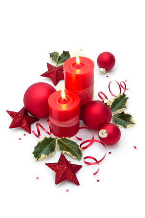 Christmas decoration with candles. Isolated on white background.