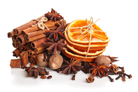 Dried orange, stars anise and cinnamon sticks  isolated on white background.