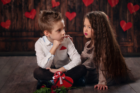boy lady: Girl and boy celebrating Valentines day. Stock Photo