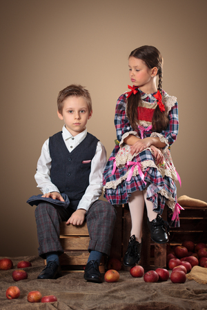 fresh girl: Girl and boy with apples and boxes. Stock Photo