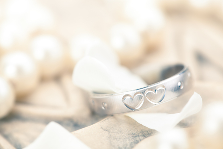 wedding heart: Silver ring with engraved hearts and flower petals.