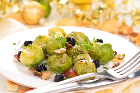 brussel: Baked Brussel sprouts with almonds and grapes for holidays.