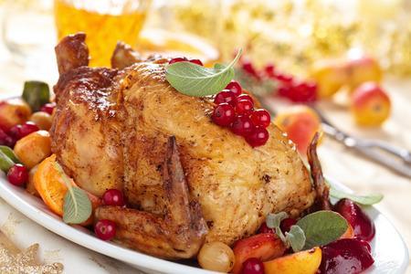 Preserved grilled chicken and various fruits on holiday table.