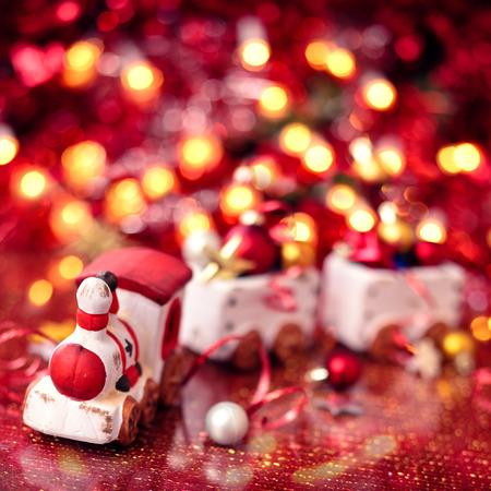 Christmas train over  holiday lights background. Shallow dof.