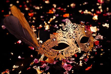 Gold carnival mask on black background. 写真素材