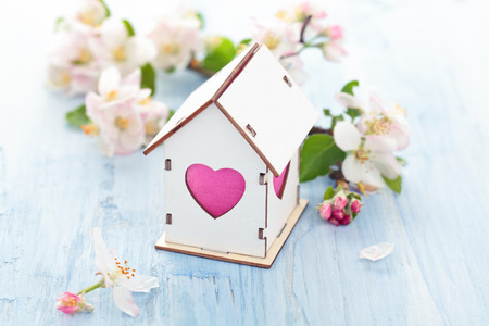 White Wood houses with colorful heart shaped windows. Stock Photo