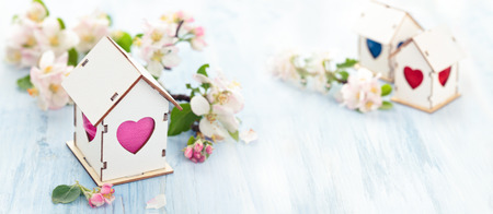 White Wood houses with colorful heart shaped windows. Standard-Bild
