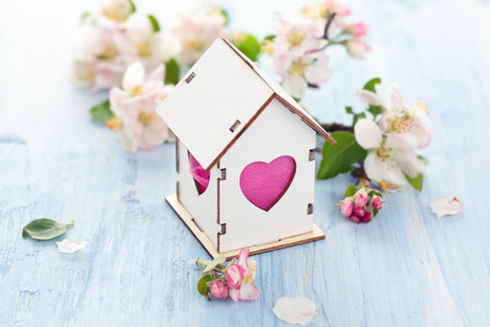 White Wood houses with colorful heart shaped windows. Banque d'images