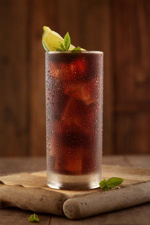 Glass of cola with ice. Stockfoto