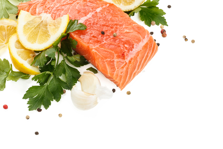 Fresh Salmon Steak with lemon and parsley. Isolated on white background. Stock Photo