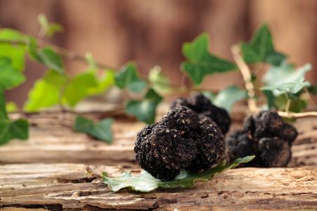 Black truffles on table.