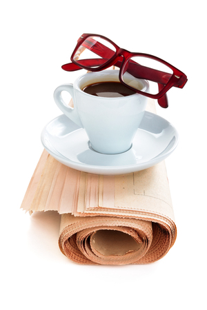Coffee and newspaper isolated on white