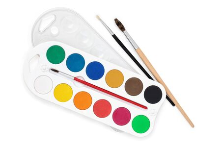 Watercolor palate and paintbrushes isolated on white background.